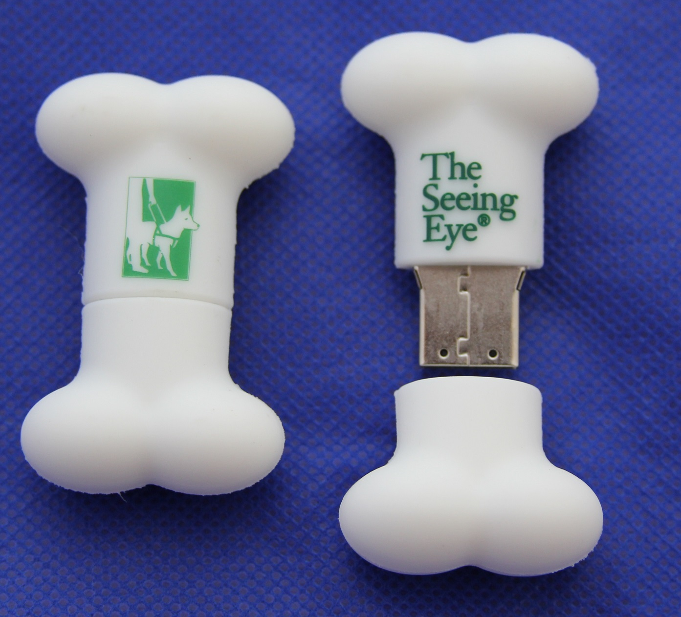 White bone-shaped flash drive with Seeing Eye logo