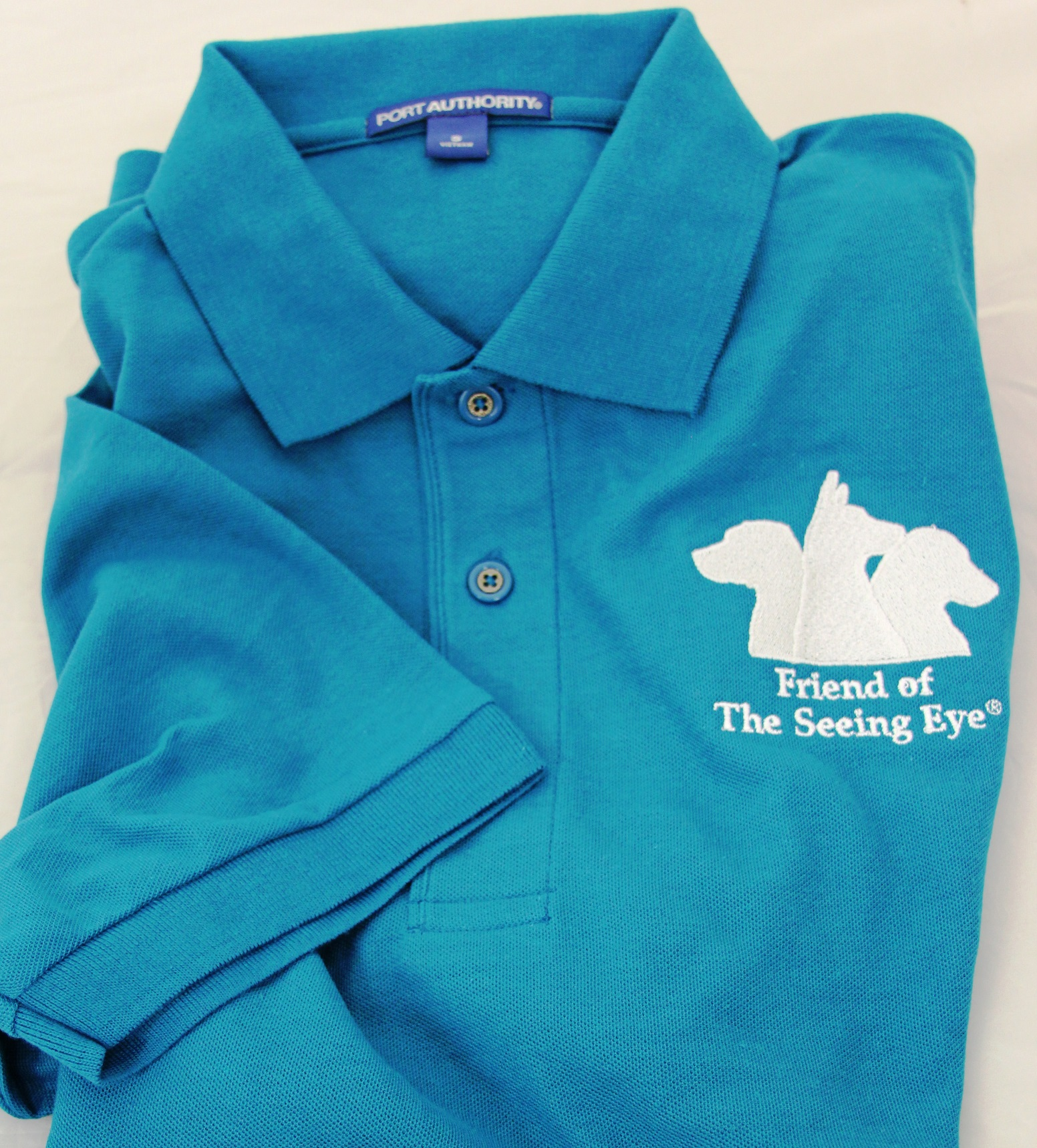 Friend of The Seeing Eye teal polo