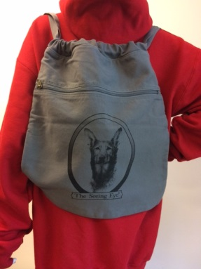 Gray drawstring backpack with shepherd
